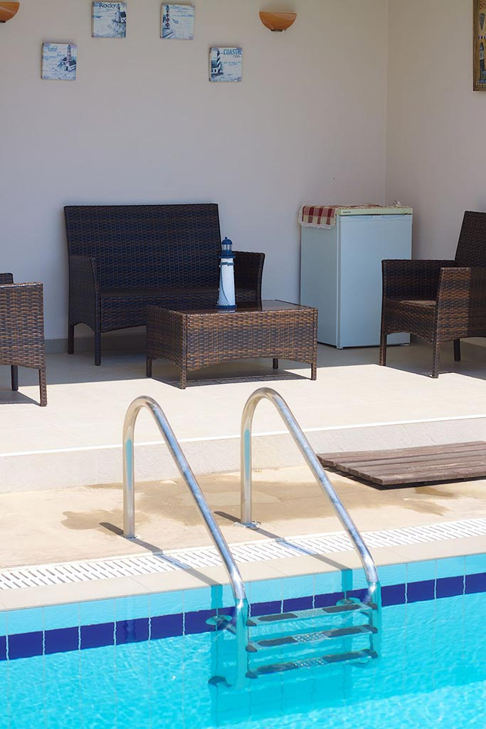 Outdoors - Sitting area in front of the swimming pool